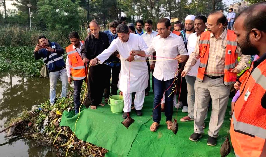 GHMC Additional Commissioner Musharraf Ali Faruqui releases oil balls in ponds and lakes for the prevention of dengue, malaria and other mosquito-borne diseases, are being manufactured, in ...