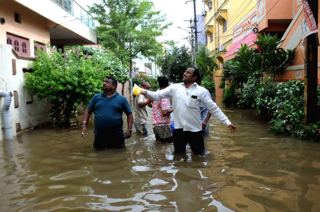 GHMC officials distribute relief material among people in the flooded areas of Hyderabad on Sep 27, 2019.