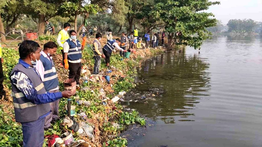 GHMC officials release oil balls in ponds and lakes for the prevention of dengue, malaria and other mosquito-borne diseases, are being manufactured, in Hyderabad on Dec 7, 2019,