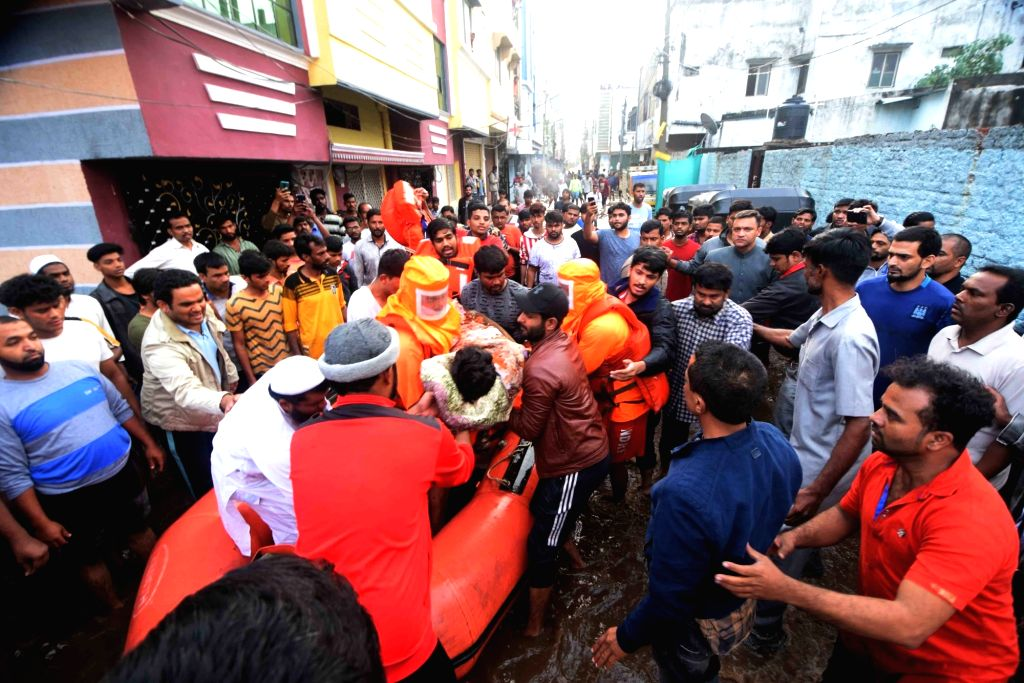 GHMC team recovers a body in front of AIMIM Floor er Akbaruddin Owaisi at Baba Nagar in Hyderabad on October 18, 2020.
