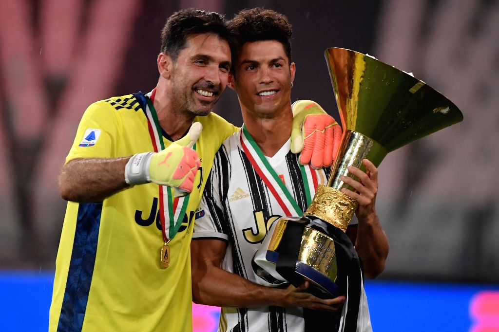 GianLuigi Buffon (L) and Cristiano Ronaldo of FC Juventus pose with the trophy at the end of the Serie A football match between FC Juventus and Roma in Turin, Italy, ...