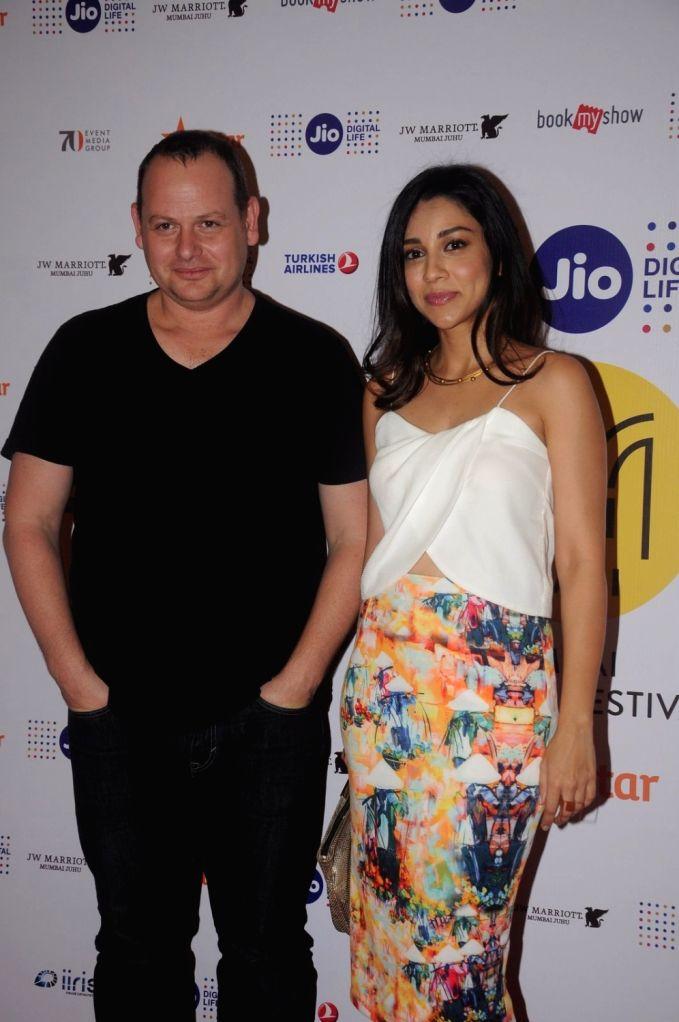 Gideon Raff with Amrita Puri arrive to attend the screening of Nikkhil Advani`s TV show `P.O.W. Bandi Yuddh Ke` at the Jio MAMI 18th Mumbai Film Festival, in Mumbai on Oct 25, 2016. - Nikkhil Advani
