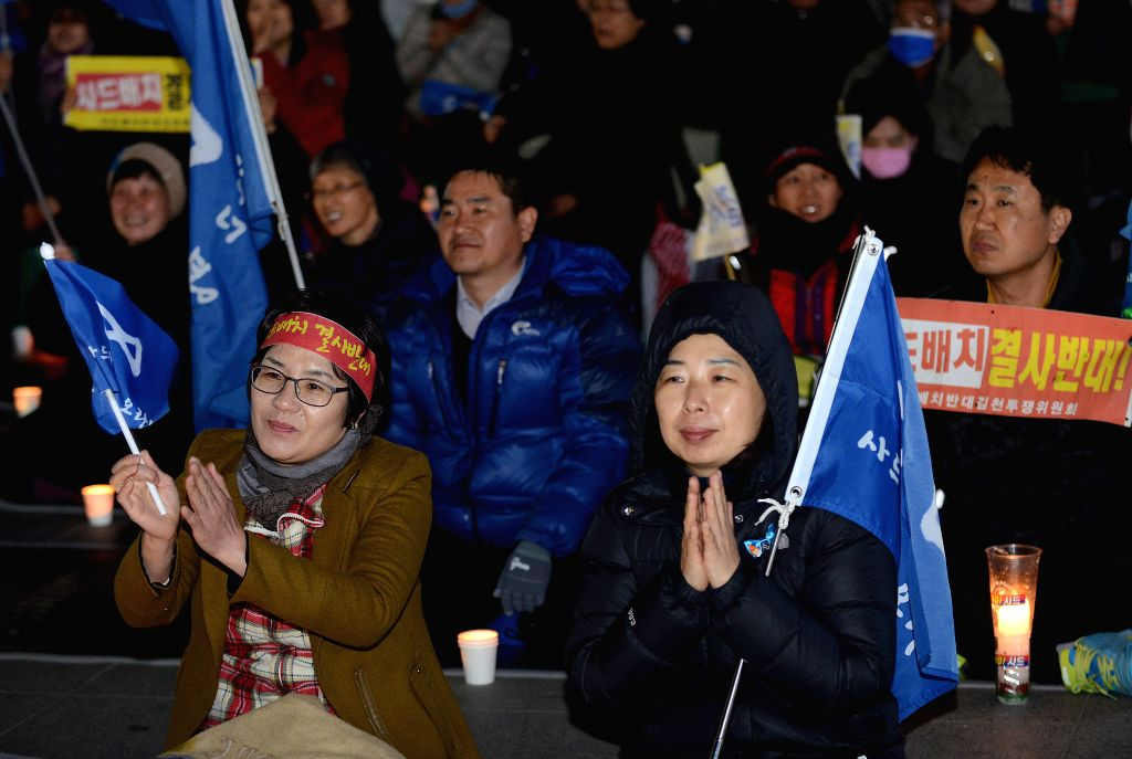 GIMCHEON, March 15, 2017 - Protestors participate in a candle-lit rally in Gimcheon, North Gyeongsang province, South Korea, March 15, 2017. About 100 protesters attended the rally on Wednesday night ...