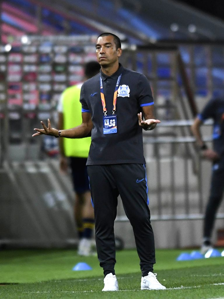 Giovanni van Bronckhorst, head coach of Guangzhou R&F, gestures during the fourth round match between Guangzhou R&F and Jiangsu Suning at the postponed 2020 ...