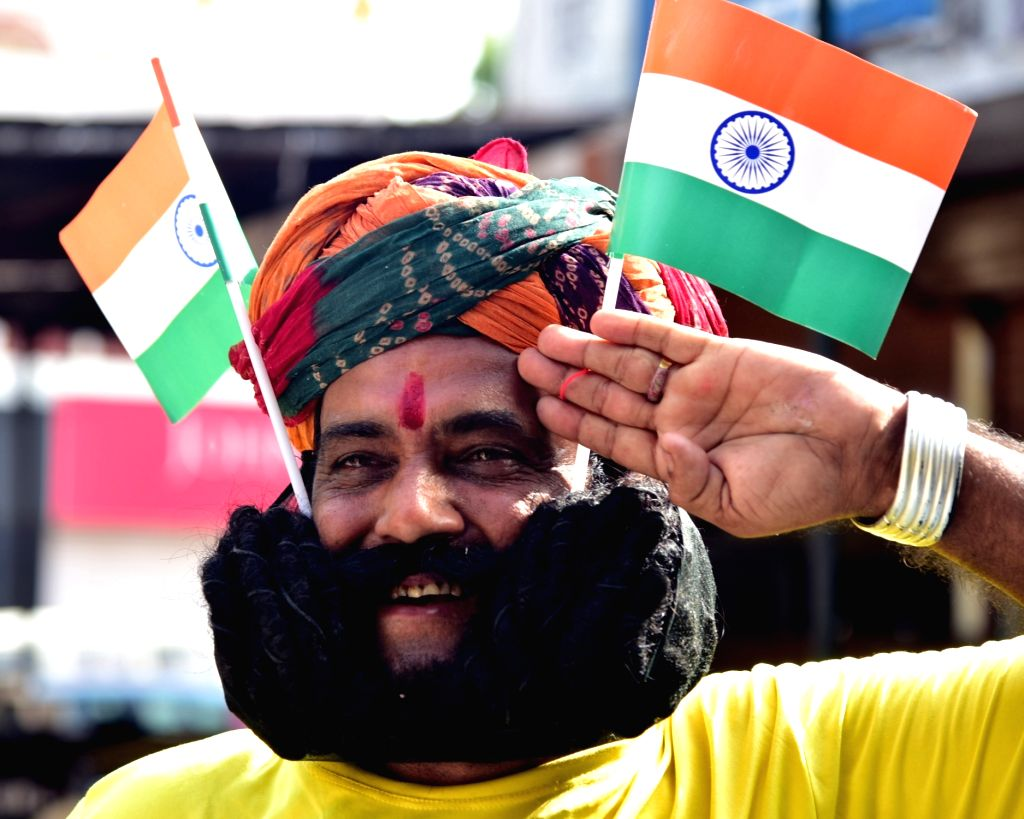 Giridhar Vyas of Rajasthan dons his 18 ft long moustaches ahead of Independence Day celebrations in Bikaner on Aug 13, 2016.