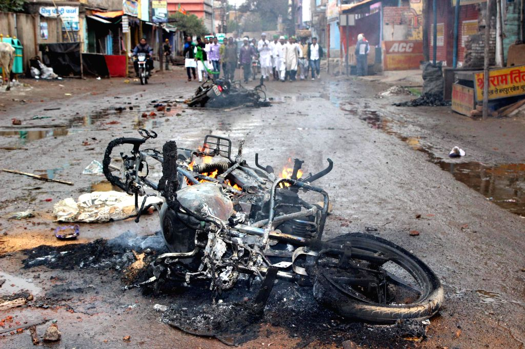 A bike set ablaze after a clash erupted between two groups in Giridih of Jharkhand on Jan 4, 2015.