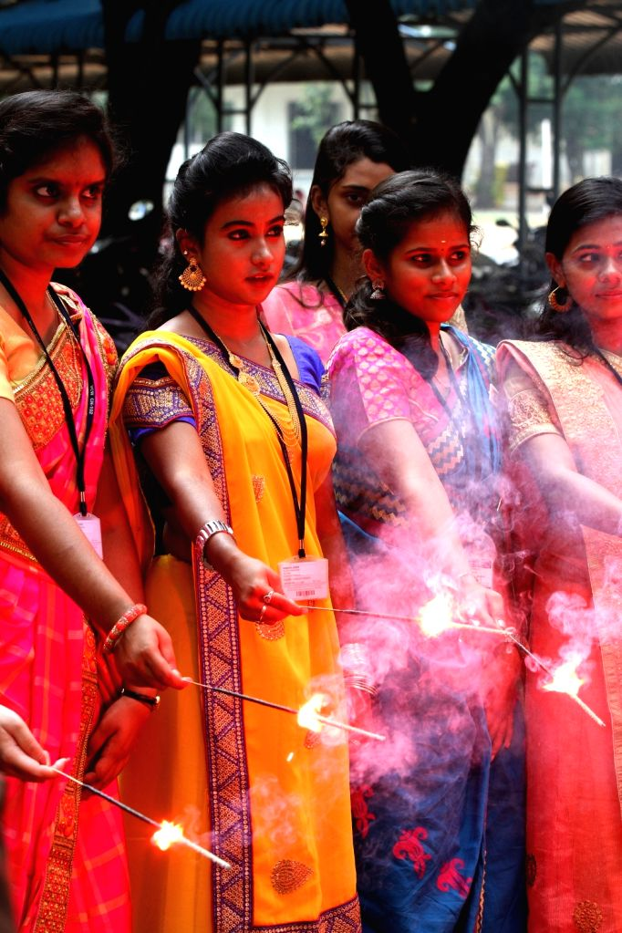 Girls burn sparklers as they participate in Diwali celebrations ahead of the festival in Chennai on Oct 25, 2019.