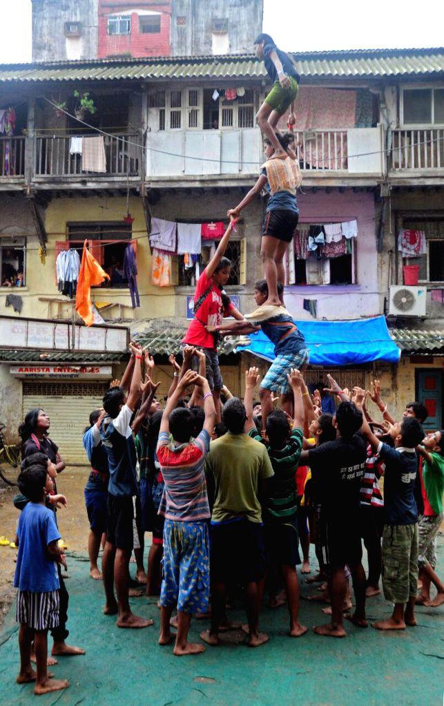 Girls busy practising ahead of Dahi Handi Festival at Parel in Mumbai on Aug 8, 2014.