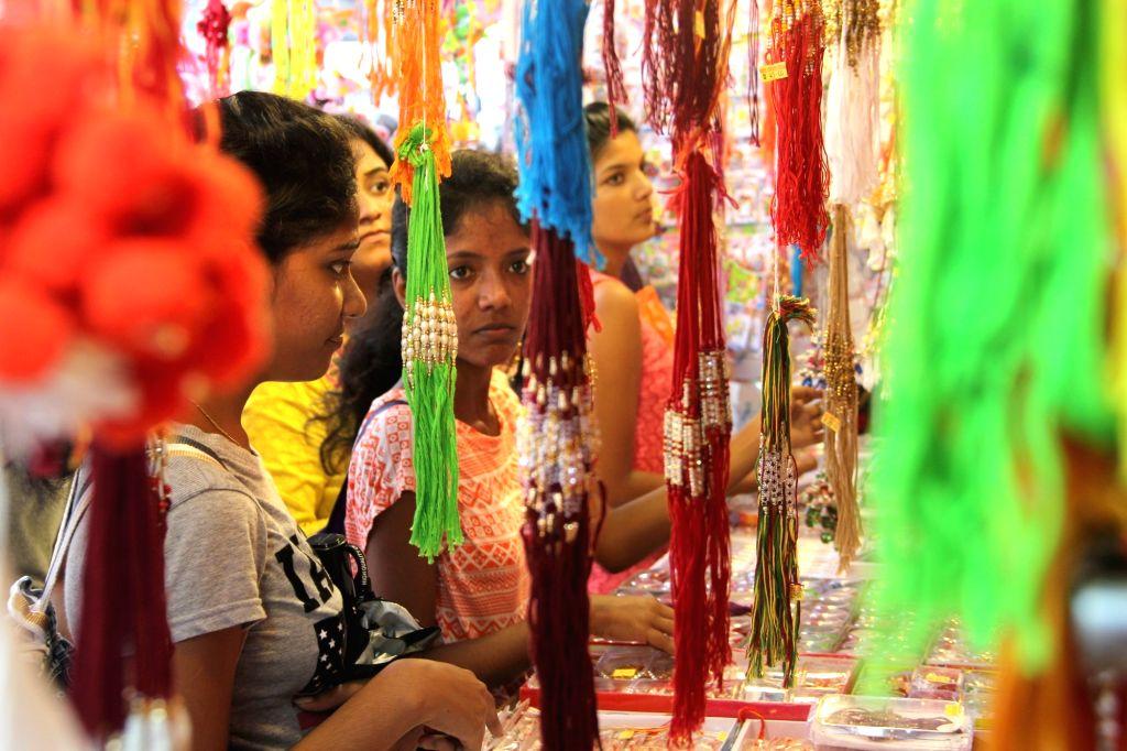 Girls busy shopping on the eve of Raksha Bandhan in Panaji, on Aug 17, 2016.