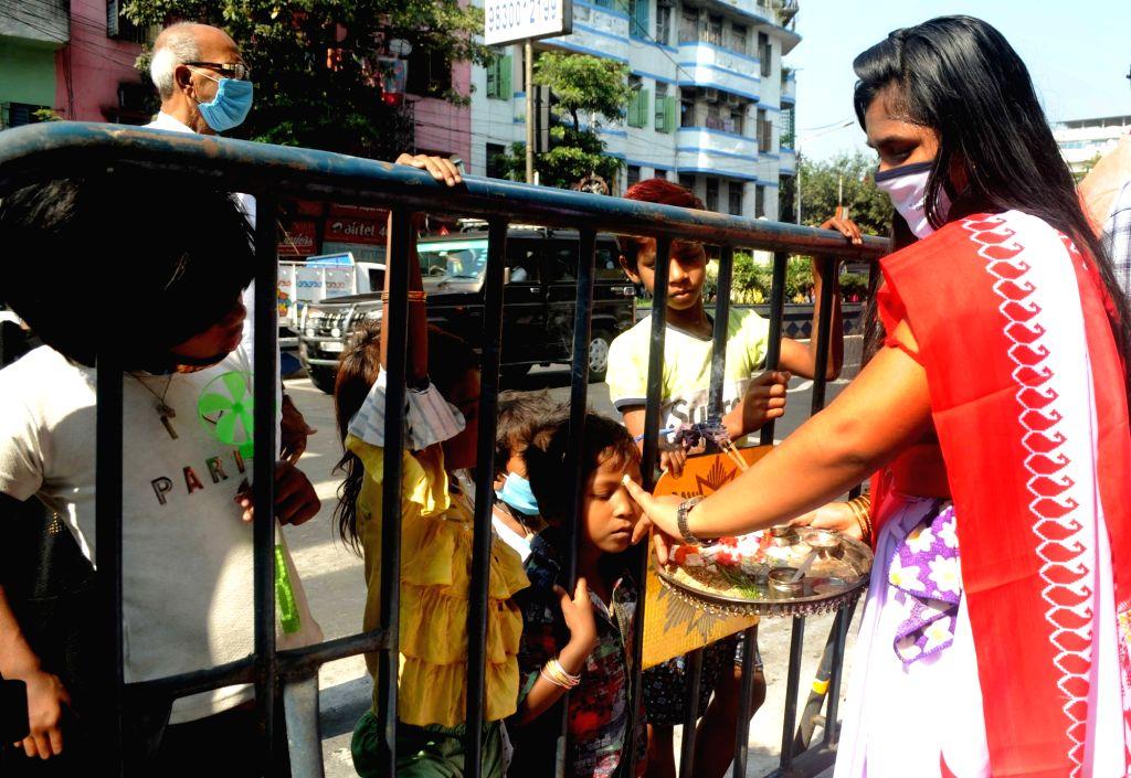 Girls celebrate Bhai Dooj with underprivileged children, in Kolkata on Nov 16, 2020.