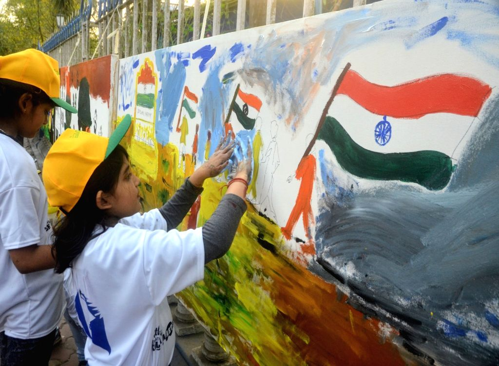 Girls participate in a painting programme to pay tributes to 49 CRPF men killed in Jammu and Kashmir's Pulwama district militant attack on 14th Feb 2019; in Kolkata, on Feb 17, 2019.