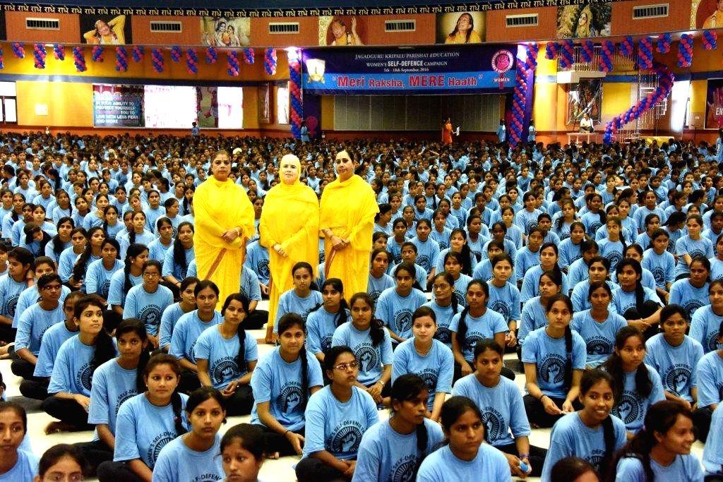 Girls participate in a self defence training programme conducted by Jagadguru Kripalu Parishat in Kunda of Uttar Pradesh's Pratapgarh on Sept 18, 2016.