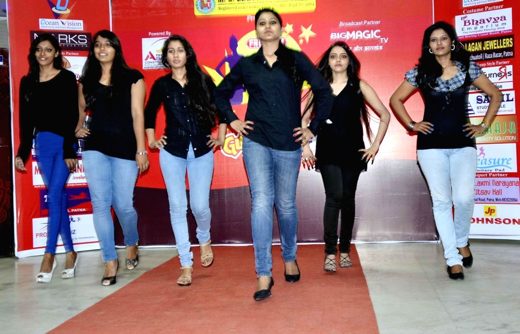 Girls participate in Miss Bihar Auditions in Patna on Dec.20, 2013.