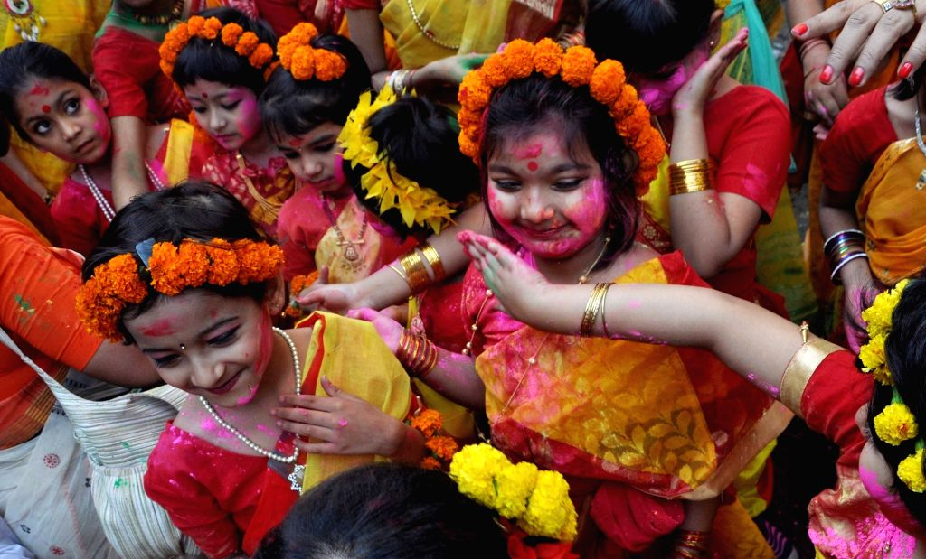Girls perform at a cultural programme during Basanta Utsav (Holi) in Kolkata on March 12, 2017.