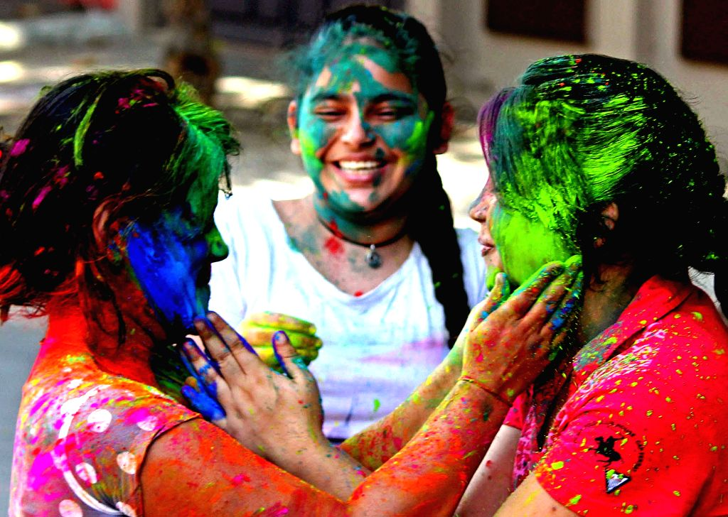 Girls play with colour to celebrate Holi festival in Bengaluru on March 12, 2017.