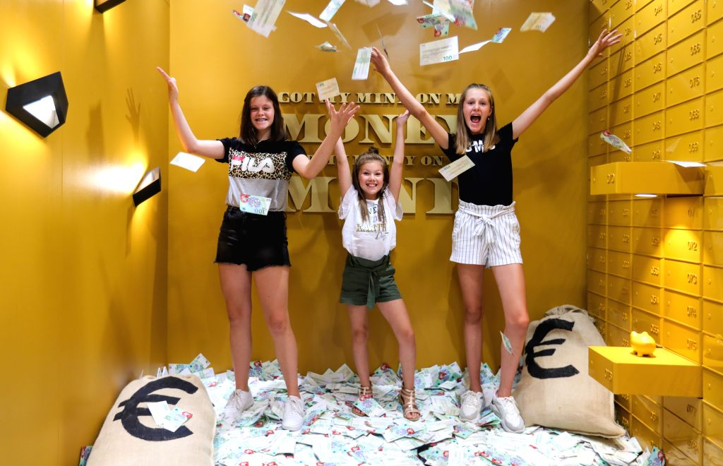 Girls pose for photo at the Smile Safari, an Instagram and TikTok museum, in Brussels, Belgium, August 7, 2020. After taking measures against the coronavirus, the ...