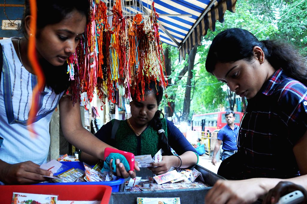 Girls purchasing Rakhis for their brothers, on the eve of Raksha Bandhan, in Bangalore on Saturday 9th August 2014.