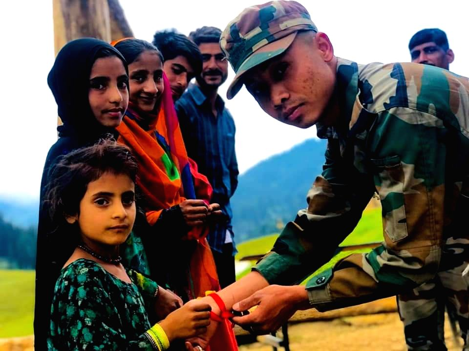 Girls tie rakhis on the wrists of an army personnel in Jammu and Kashmir's Kupwara district on the occasion of Raksha Bandhan on Aug 3, 2020.