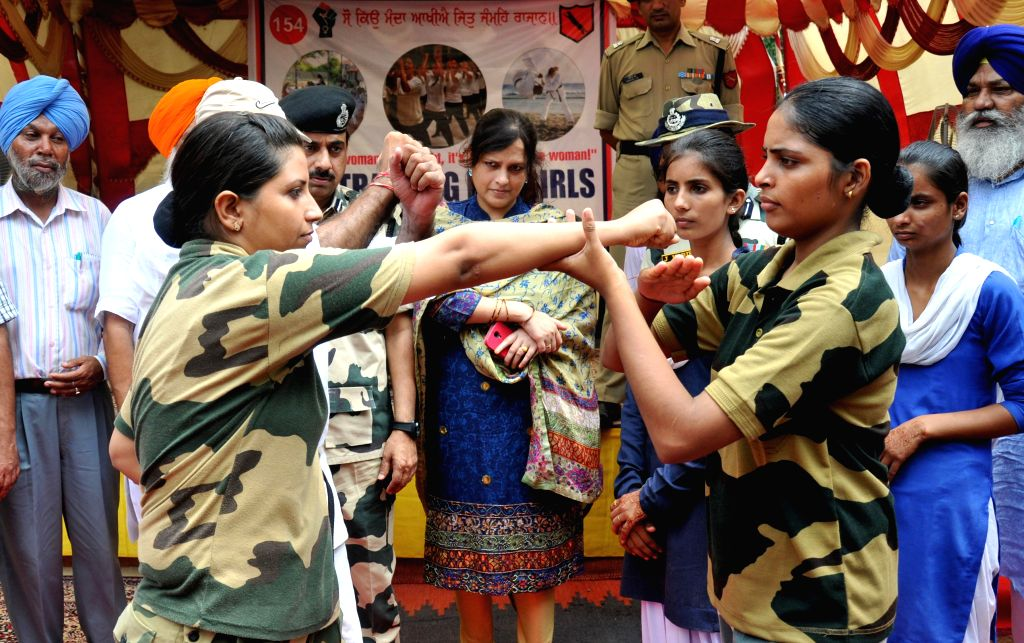 Girls undergo self-defence training at Civic Action Training Camp set-up by BSF at Attari near Amritsar on July 28, 2014.