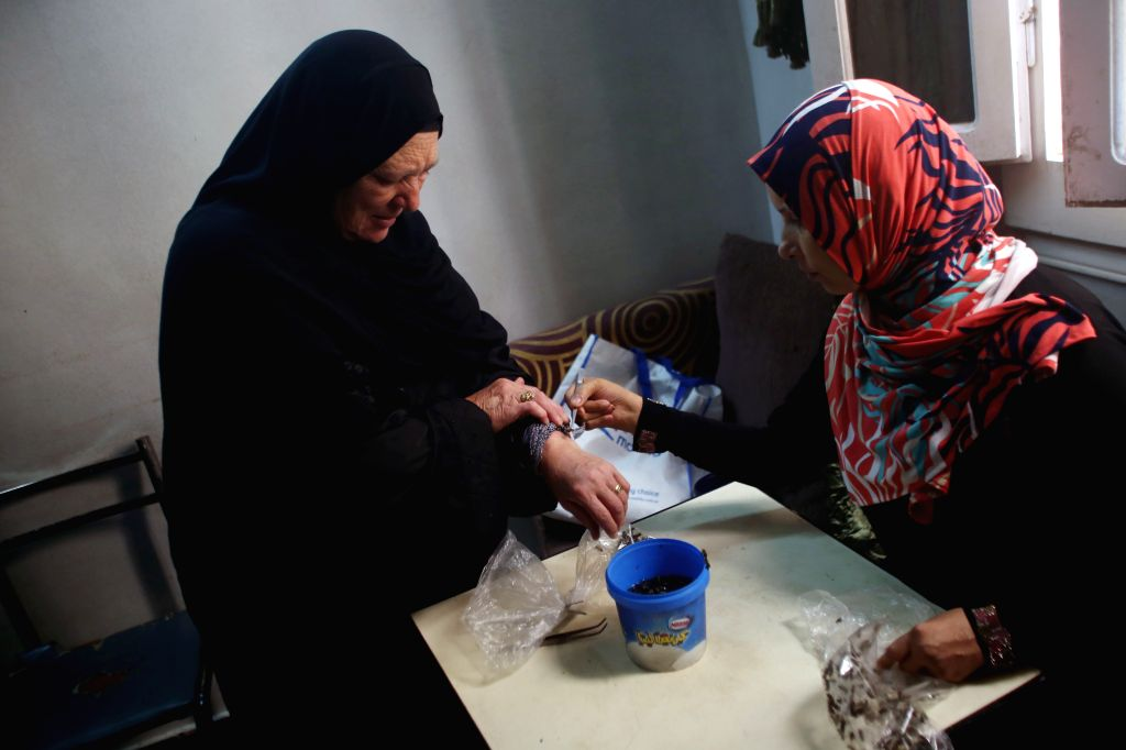 GIZA, Oct. 2, 2016 - Al-Sayeh (R) treats a patient with the sting of a living bee in Giza Governorate, Egypt, Sept. 30, 2016. Al-Sayeh, together with her younger brother Ibrahim, has been treating ...