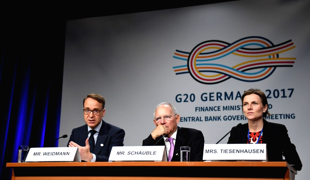 (gl/IANS)WASHINGTON D.C., April 22, 2017 Jens Weidmann (L), president of the German central bank, and German Finance Minister Wolfgang Schaeuble (C) attend the G20 Presidency press ... - Wolfgang Schaeuble