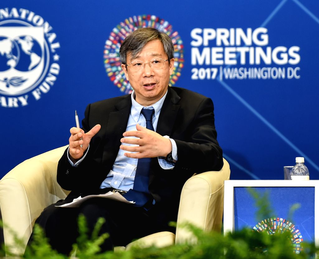 (gl/IANS)WASHINGTON D.C., April 22, 2017 Yi Gang, deputy governor of the People's Bank of China (PBOC), speaks at a forum during the International Monetary Fund (IMF) and World Bank ...
