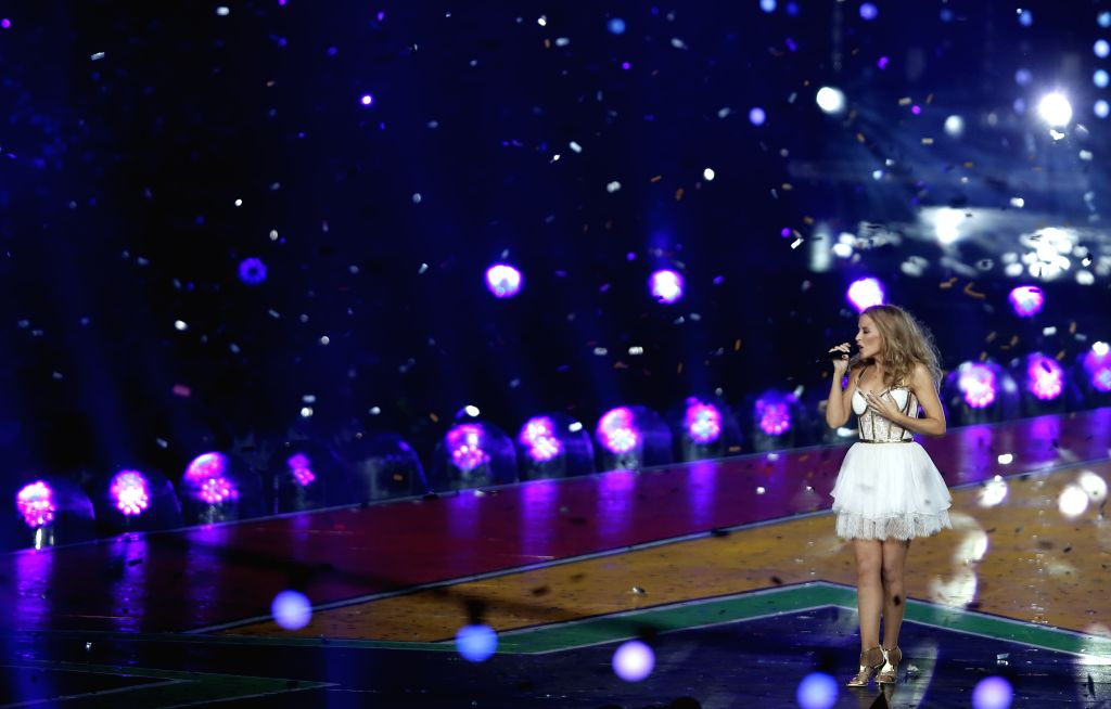 Australian singer Kylie Minogue performs during the closing ceremony for the Glasgow 2014 Commonwealth Games at the Hampden Park in Glasgow, the United Kingdom, on ..