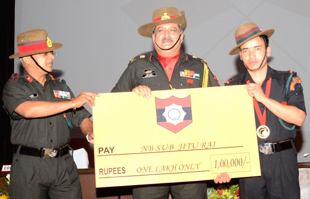 Glasgow CWG gold medallist in in the men's 50 Metres Pistol event, Jitu Rai being felicitated by Gurkha Regiment in Lucknow on Aug 12, 2014.
