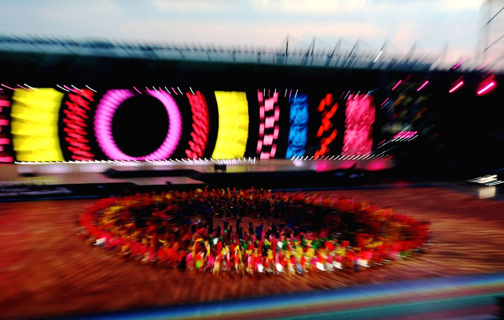 Dancers perform during the opening ceremony of the XX Commonwealth Games at the Celtic Park in Glasgow, Britain, on July 23, 2014.