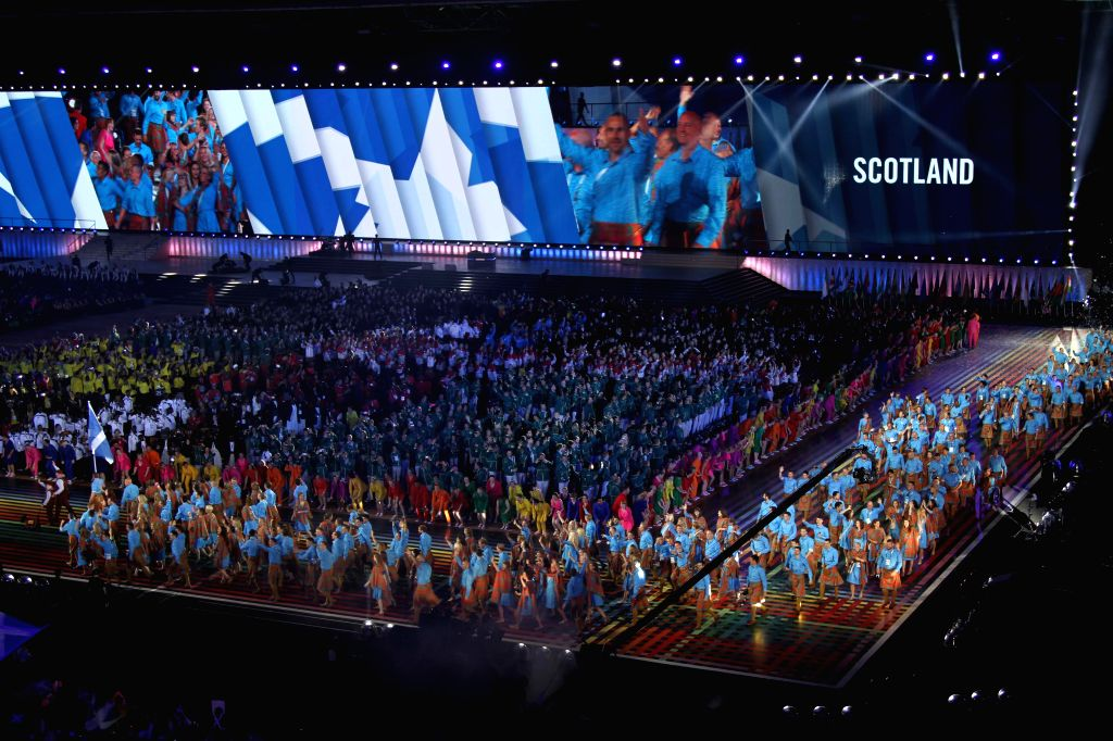 Members of the Scotish delegation attend the opening ceremony of the XX Commonwealth Games at the Celtic Park in Glasgow, Britain, July 23, 2014. (Xinhua/Guo ...