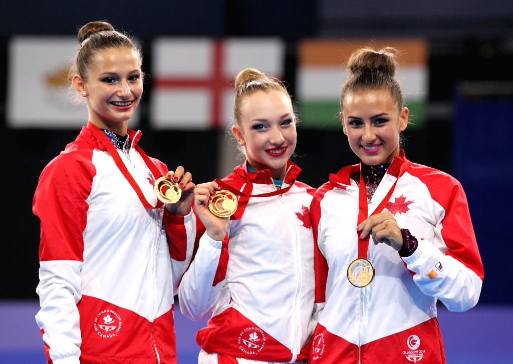 Athletes of Canada pose during the the awarding ceremony for Team Final of Gymnastics Rhythmic at the 2014 Glasgow Commonwealth Games held in Glasgow, Scotland on ..