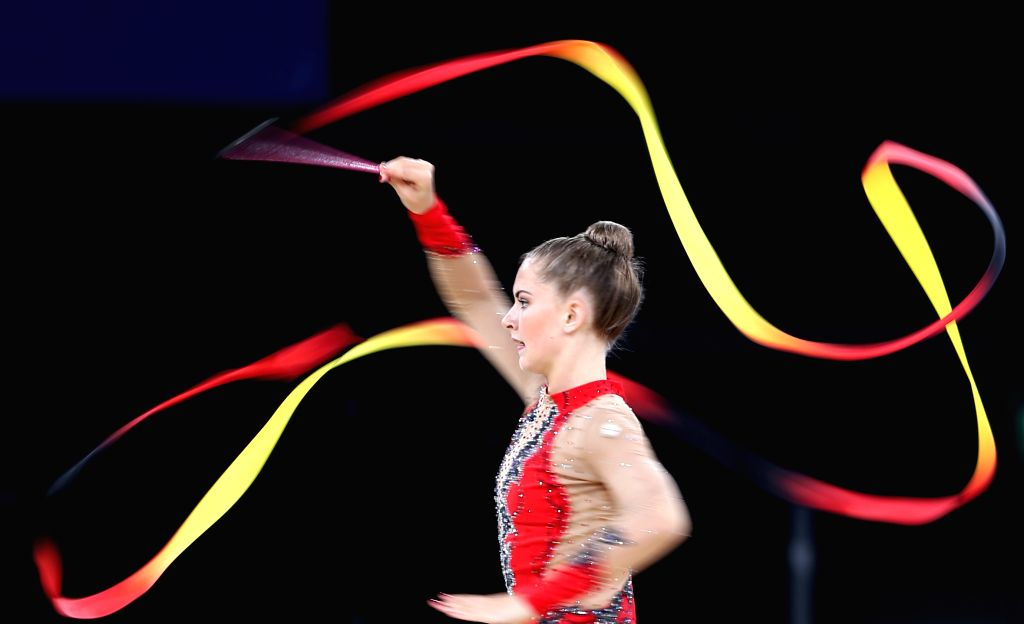 Lauren Brash of Scotland competes during the ribbon competition of the Team Final and Individual qualification of Gymnastics Rhythmic at the 2014 Glasgow ...
