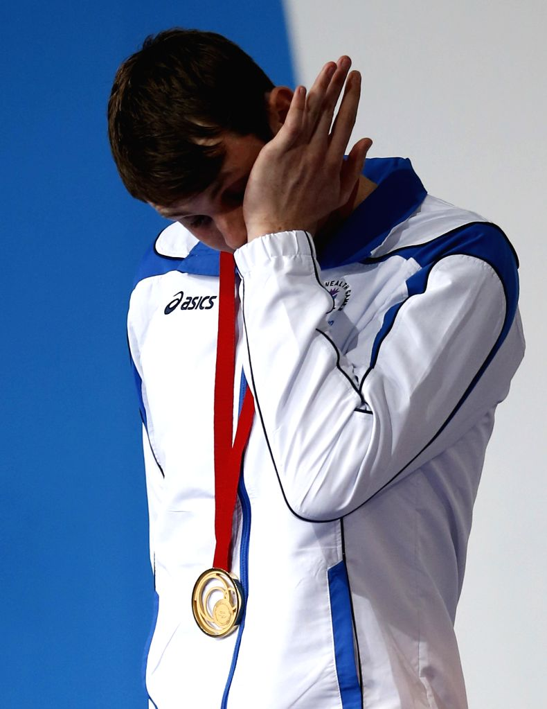Ross Murdoch of Scotland brushes away tears during the medal ceremony for Men's 200m Breaststroke Final during day 1 of the Glasgow 2014 Commonwealth Games at ...