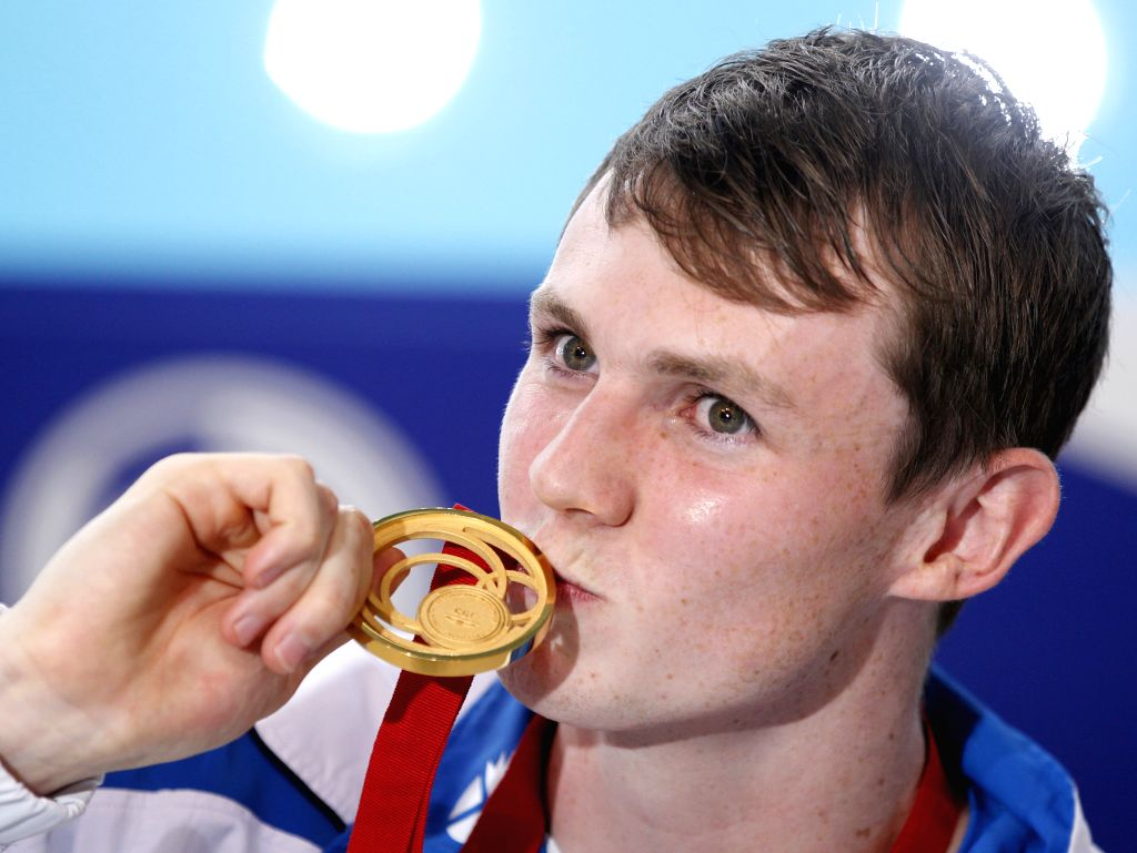 Ross Murdoch of Scotland kisses his gold medal after the medal ceremony for Men's 200m Breaststroke Final during day 1 of the Glasgow 2014 Commonwealth Games at ...