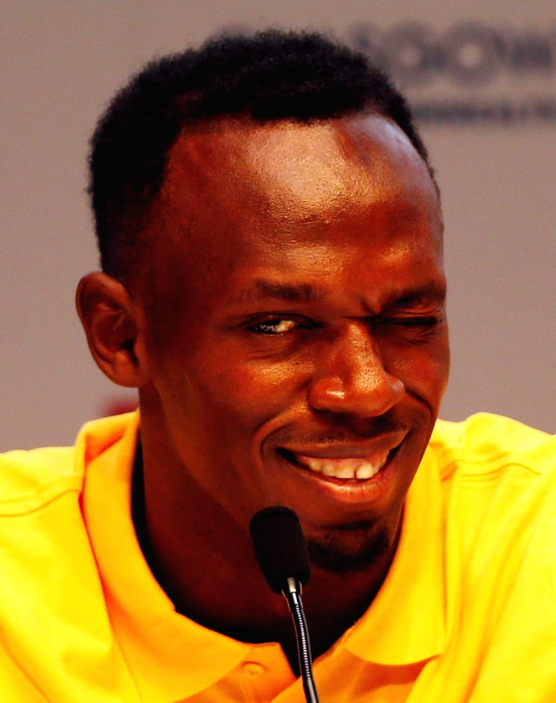 Usain Bolt of Jamaica winks during a press conference on day 3 of the Glasgow 2014 Commonwealth Games in the Loch Lomond room at the MPC in Glasgow, Scotland on ...