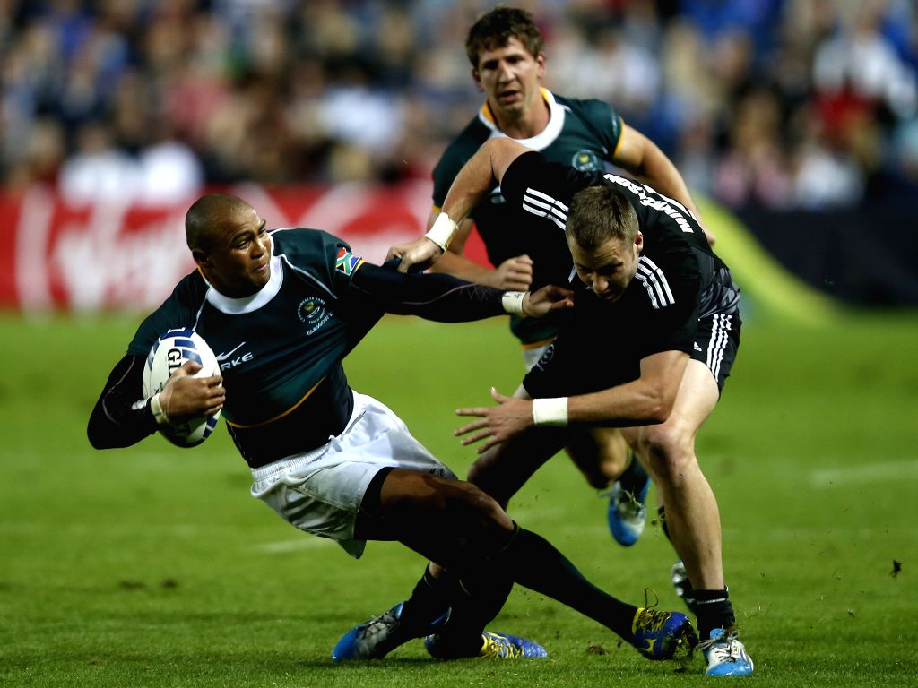 Cornal Hendricks (L) of South Africa is tackled by Tim Mikkelson of New Zealand during the gold medal match of Men's Rugby Sevens during day 4 of the Glasgow 2014 ..