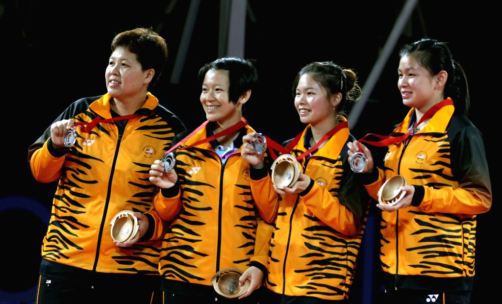 Players of Malaysia pose on the podium during the awarding ceremony for the women's team final of table tennis at the 2014 Glasgow Commonwealth Games in Scotstoun ..