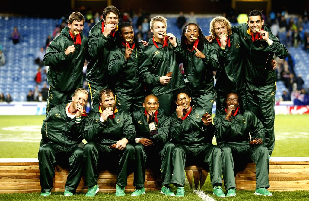 Team members of South Africa pose with the medals after the gold medal match of Men's Rugby Sevens during day 4 of the Glasgow 2014 Commonwealth Games at Ibrox ...