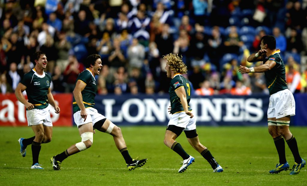 Werner Kok (2nd R) of South Africa celebrates with teammates after the gold medal match of Men's Rugby Sevens during day 4 of the Glasgow 2014 Commonwealth Games at