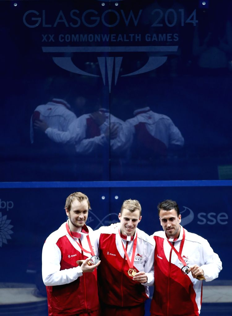 Gold medalist Nick Matthew(C) of England poses with his fellows silver medalist James Willstrop(L) and bronze medalist Peter Barker during the medal ceremony for ...