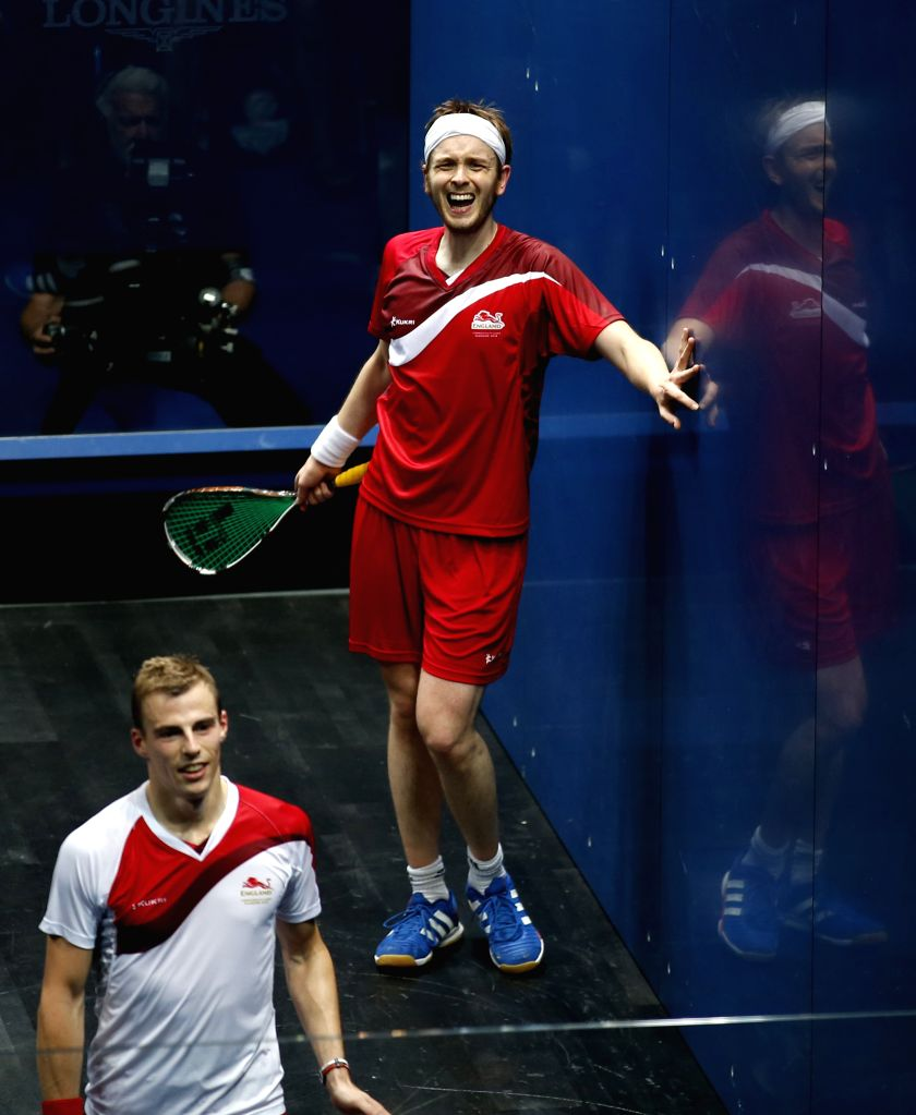 Nick Matthew of England and James Willstrop(R) of England react to the judge during their Men's Singles Gold medal Final of Squash on day 5 of the Glasgow 2014 ...