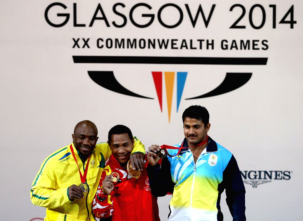 Medalists pose during the awarding ceremony for the men's 94kg final of weightlifting at the 2014 Glasgow Commonwealth Games in Glasgow, Scotland on July 29, 2014. .