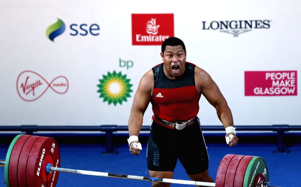 Steven Kukuna Kari of Papua New Guinea celebrates after a successful lift during the men's 94kg final of weightlifting at the 2014 Glasgow Commonwealth Games in ...