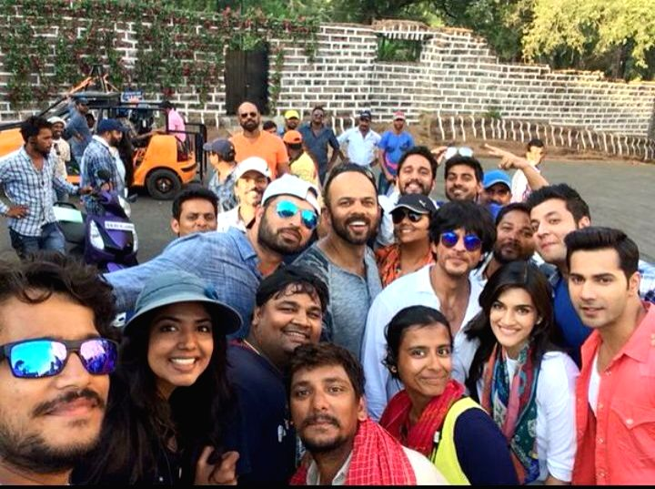 Actors Shah Rukh Khan, Varun Dhawan and Kriti Sanon with director Rohit Shetty on the sets of upcoming film `Diwale` in old Goa on April 14, 2015.