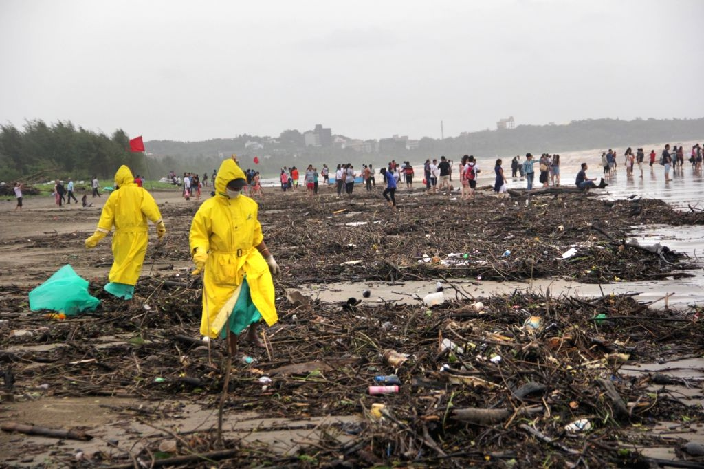Goa: Beaches being cleaned after waves deposited huge amount of debris along the stretch between Miramar and Dona Paula in Goa, on July 30, 2017.  (Photo: IANS)