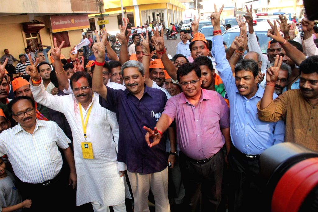 Goa Chief Minister and BJP leader Manohar Parrikar celebrates party's performance in 2014 Lok Sabha Elections with party workers in Panaji on May 16, 2014.