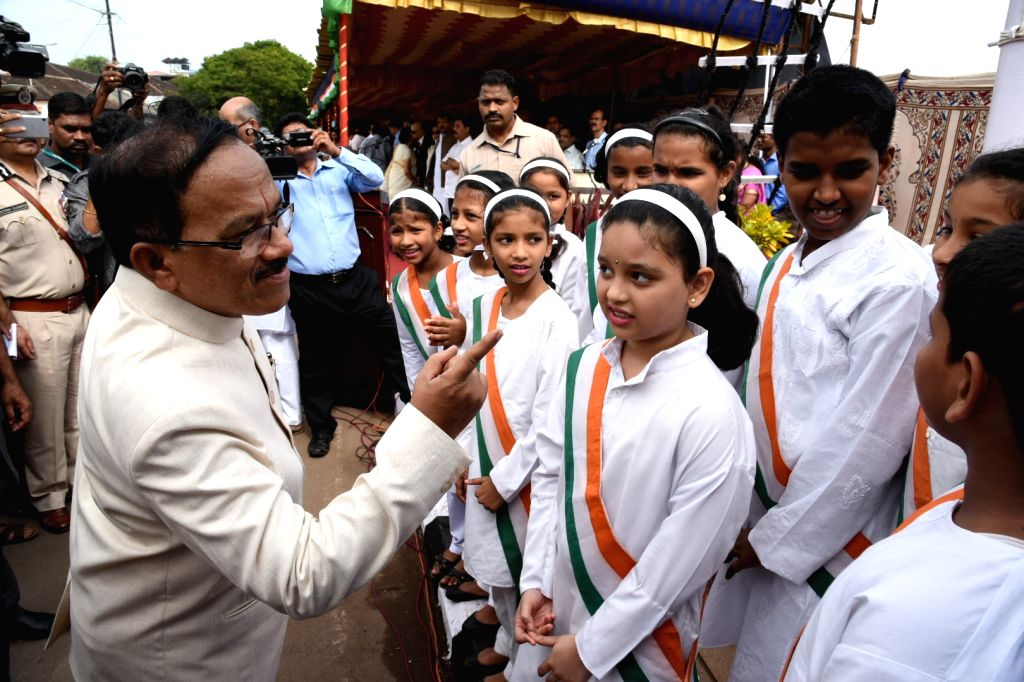 Goa Chief Minister Laxmikant Parsekar interacts with children during Independence Day celebration at Old Secretariat in Panaji on Aug 15, 2016. - Laxmikant Parsekar