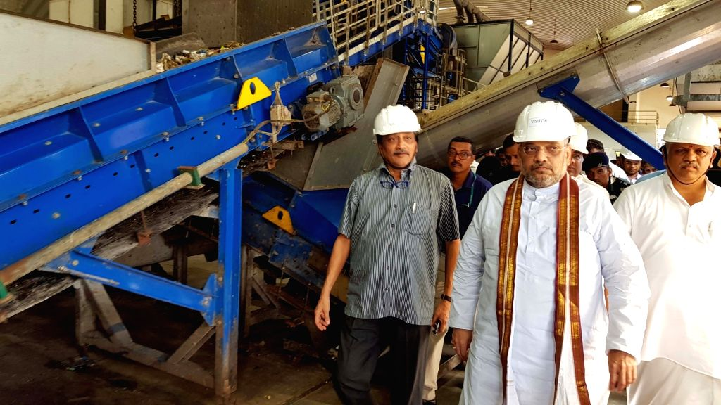 Goa Chief Minister Manohar Parrikar and BJP President Amit Shah visit a garbage treatment plant at Saligao on July 2, 2017. - Manohar Parrikar and Amit Shah