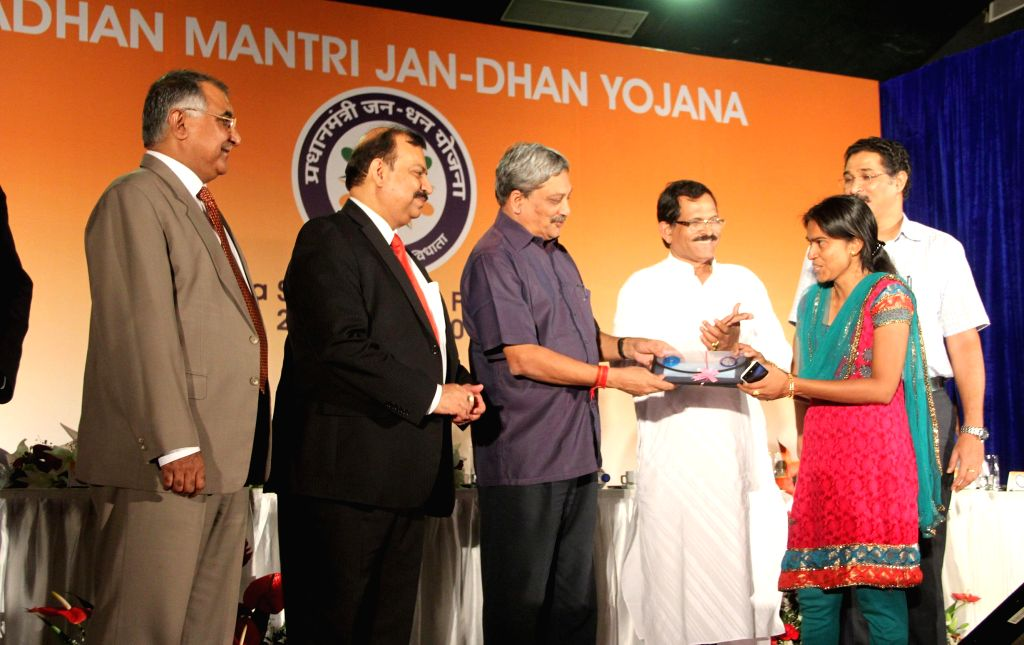 Goa Chief Minister Manohar Parrikar, Union Minister of State for Tourism and Culture, Shripad Yeso Naik at the inaugural function of Prime Minister Jan-Dhan Abhiyan in Taleigao of Goa on Aug 28, ... - Manohar Parrikar