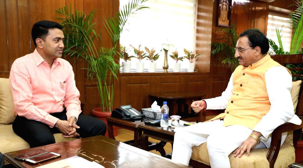 Goa Chief Minister Pramod Sawant meets Union Human Resource Development Minister Ramesh Pokhriyal ???Nishank???, in New Delhi on June 14, 2019. - Pramod Sawant